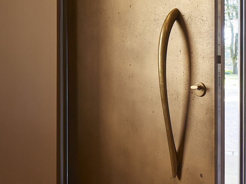 bz4 bronze handle on a vintage bronze door urbanfront
