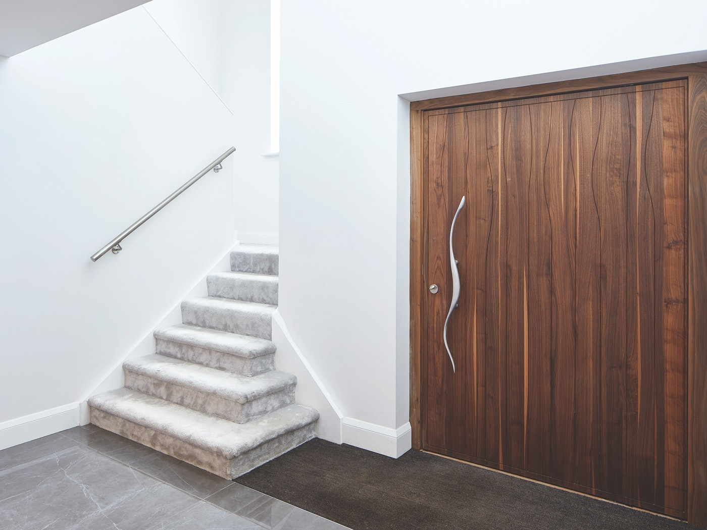 Choose a statement handle, this one follows the wave pattern on the door