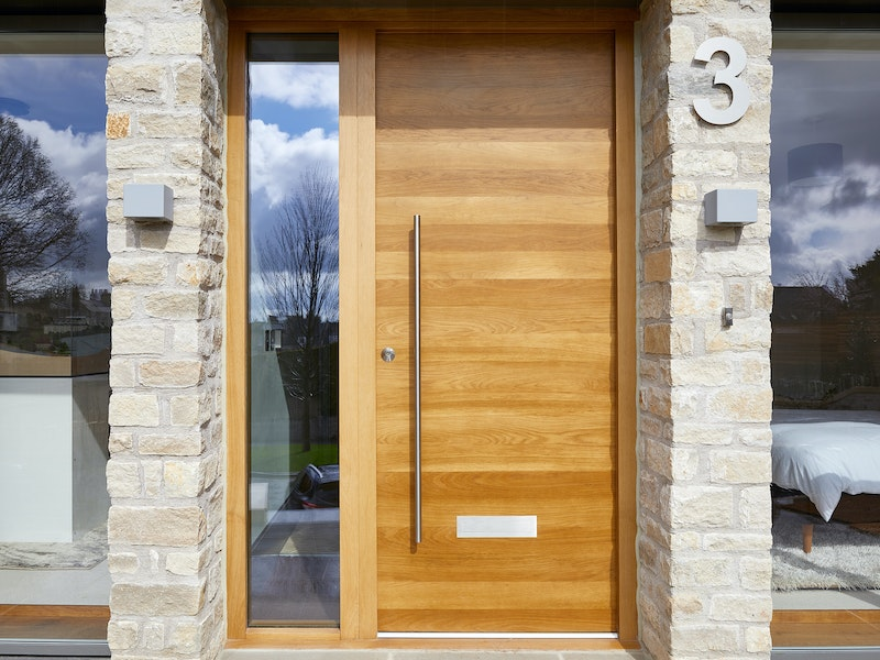 Using a large door number by a simple door creates interest