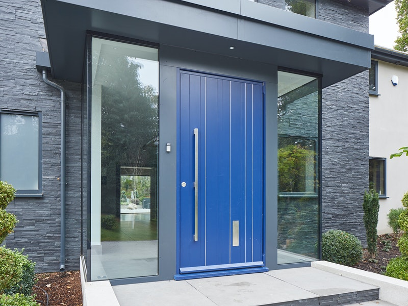 this glass box entrance certainly creates an attractive result