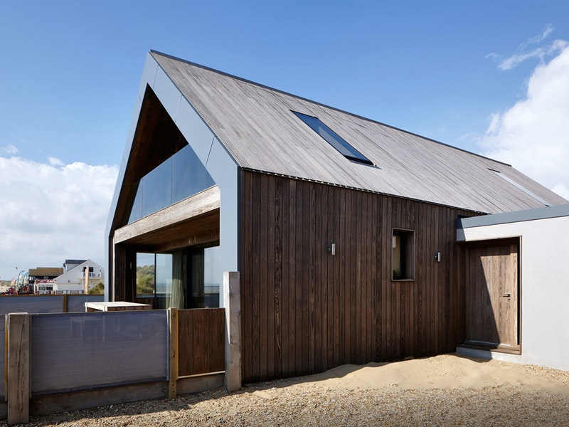 Using kebony timber for both the door and cladding visually strengthens the simple form