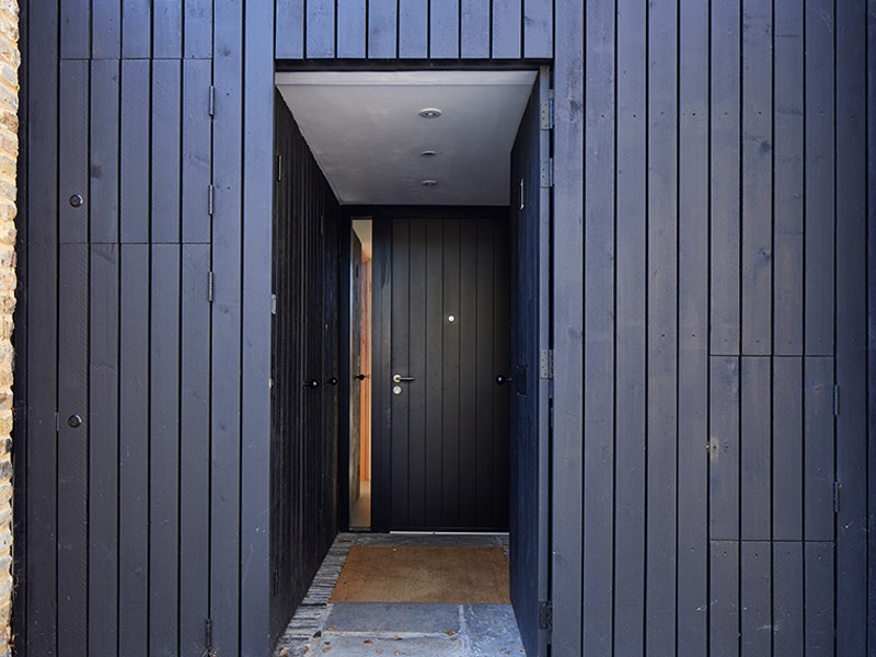 Black door with black cladding