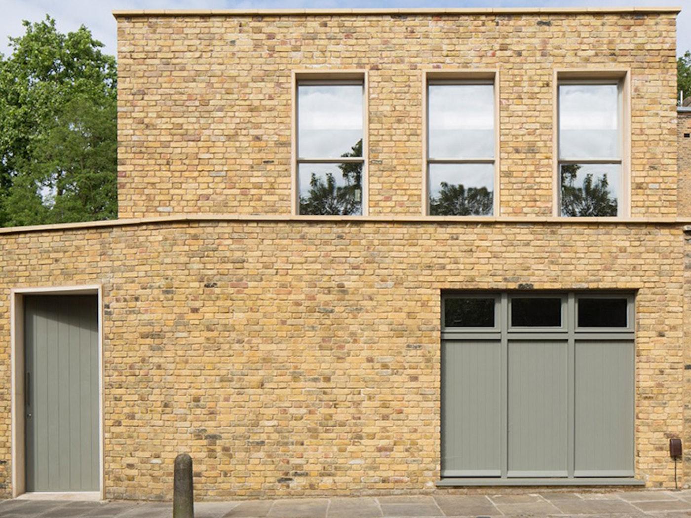 A sage green colour lifts the yellowish brick