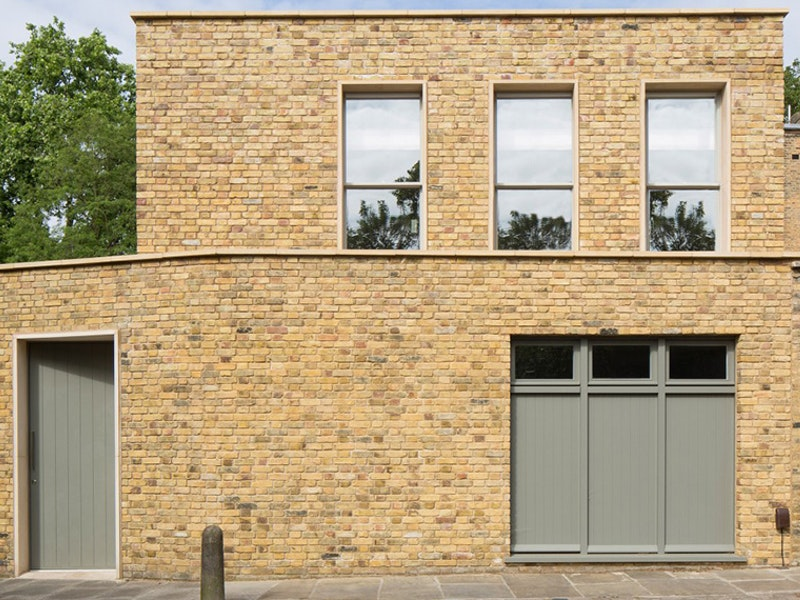 A sage green colour lifts the yellowish brick