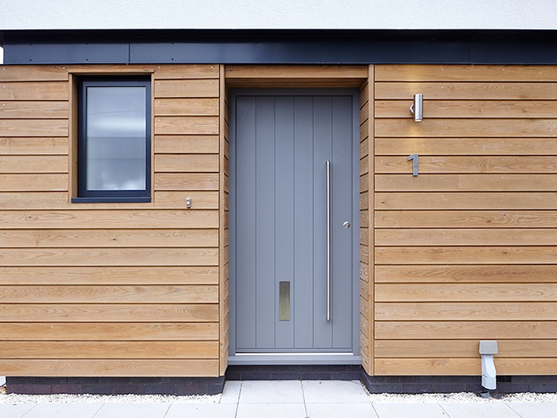 Steel beams, cladding and white render choosing a light grey is safe but also effective