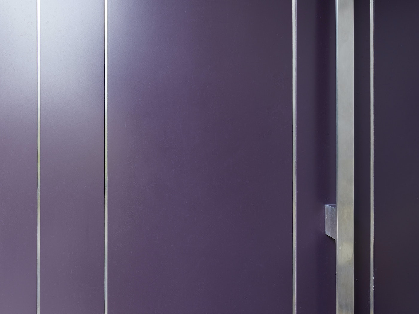 This close up shows the smooth painted purple finish and stainless steel detailing
