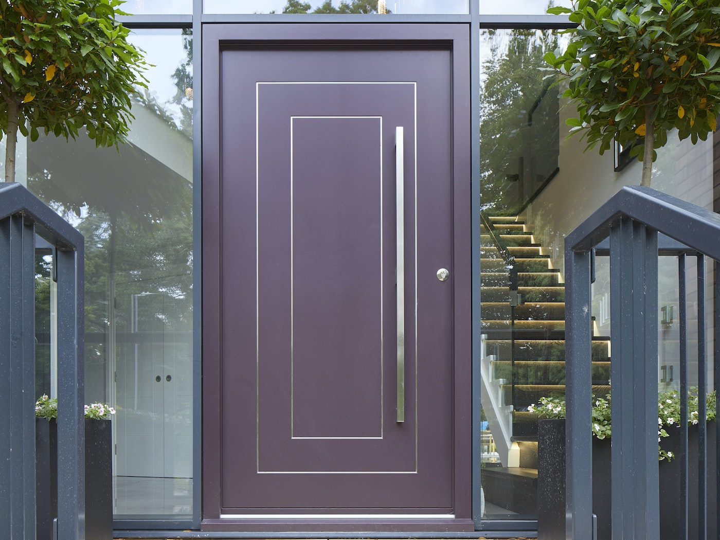 This Form purple front door features stainless steel strips in rectangular or square design and these elevate the contemporary styling