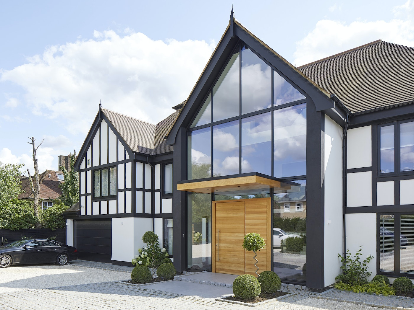 This house is a grand mix of contemporary with traditional styling - the modernity is highlighted by the simple grooved contemporary front door