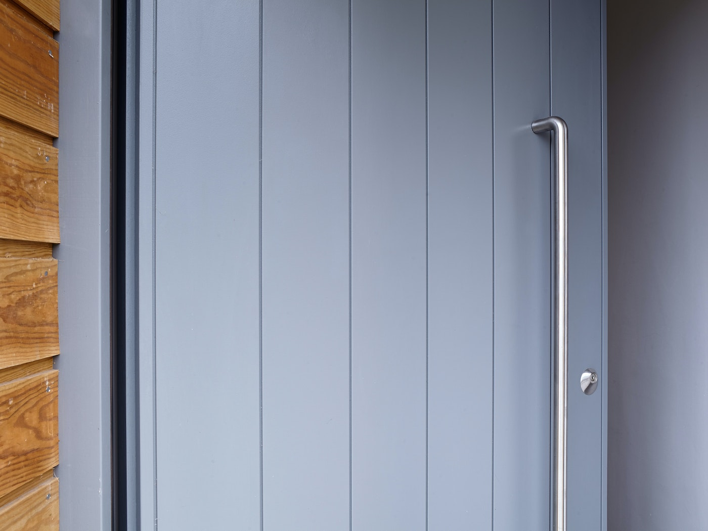 A large handle on an otherwise normal sized door will draw attention