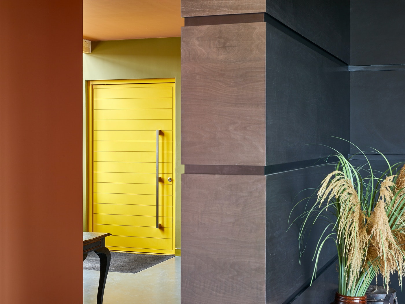 This bright door is complimented by a statement handle