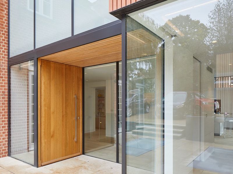 This above the door canopy is integrated along with the door, into a glass walled design