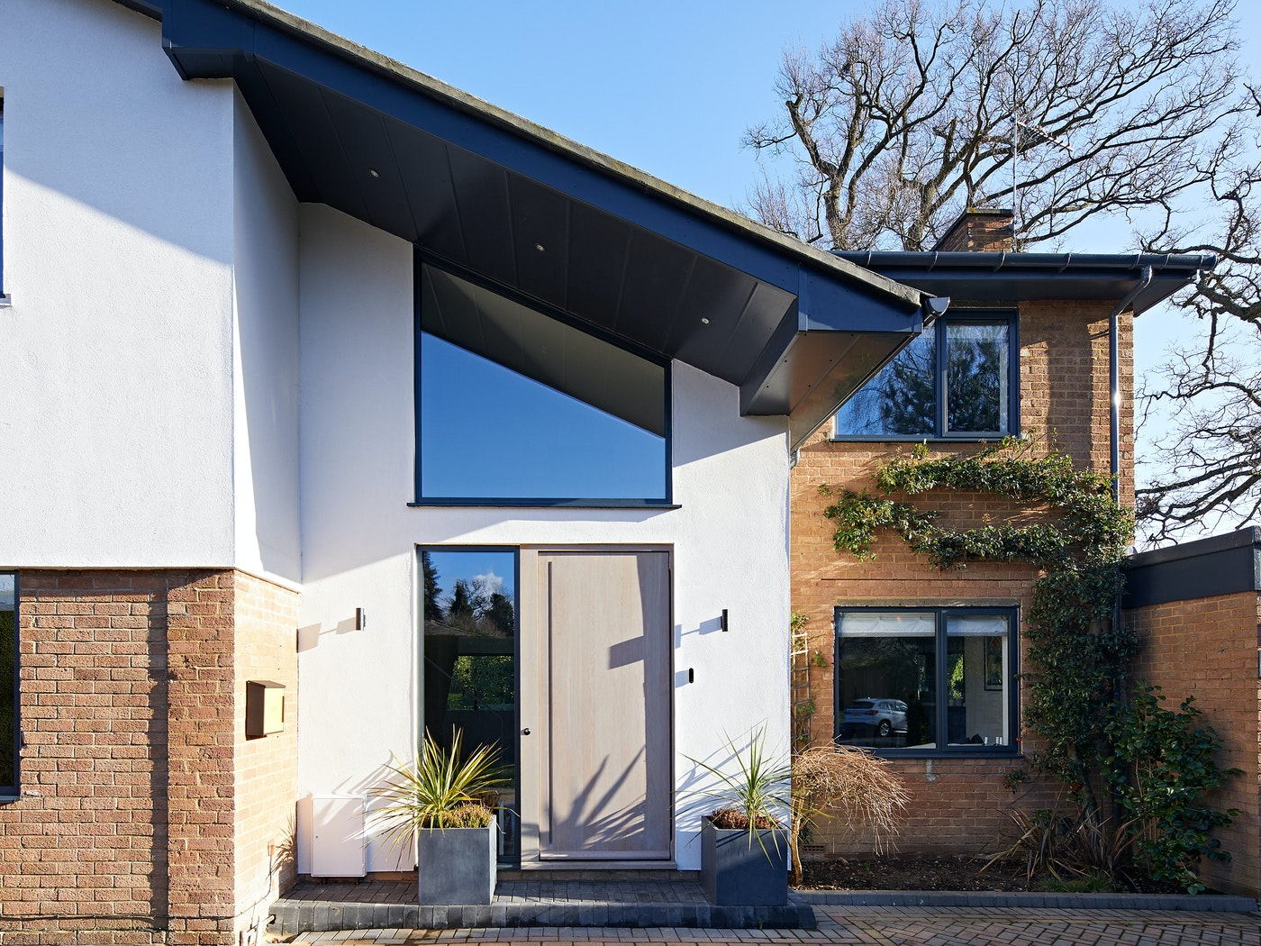 The roof & soffit of this house create an extensive overhang