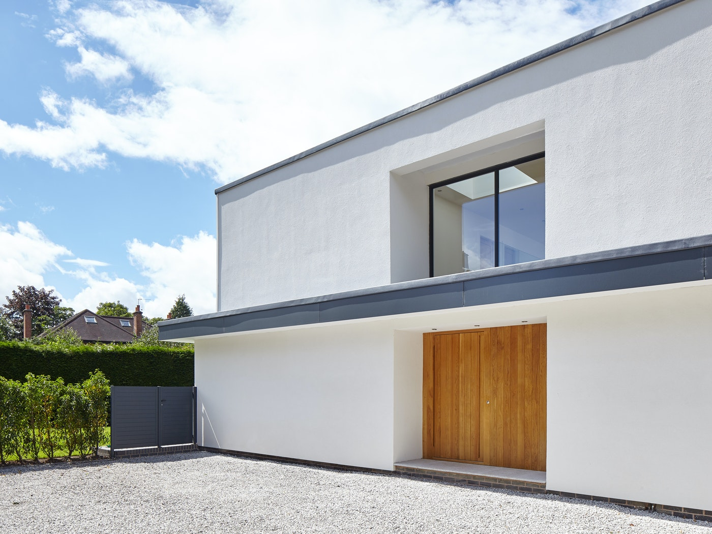 This flat overhang forms a part of the building design and gives excellent coverage to the flush front door
