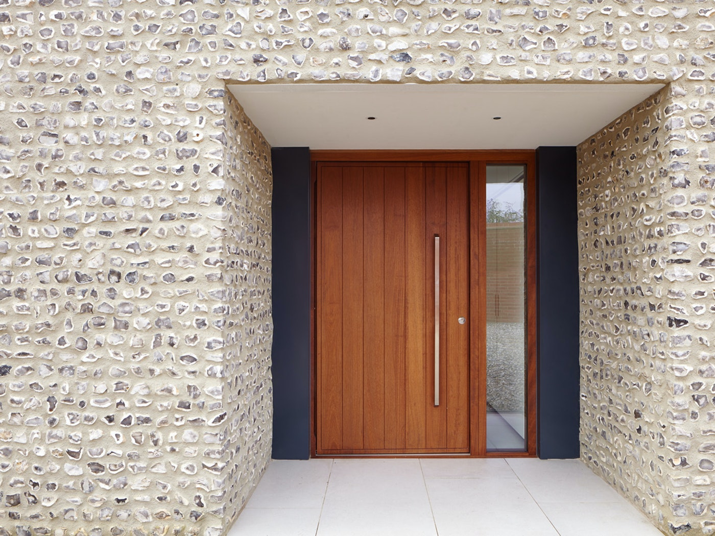 This door is set well back underneath a covered entrance offering great protection