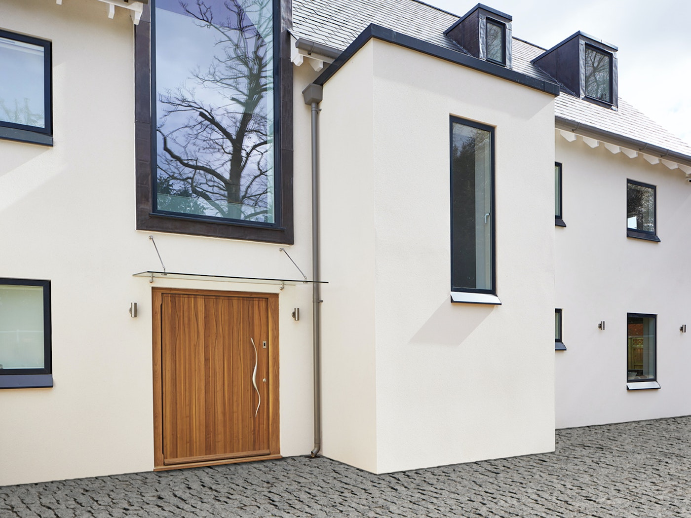 A glass door canopy provides an elegant design feature as well as protection