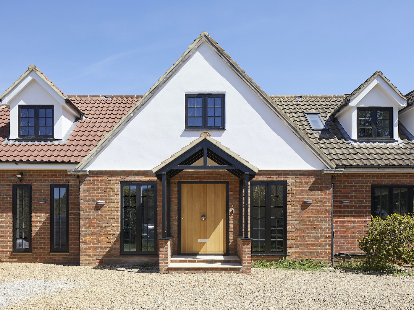 A traditionally styled brick house will look fantastic with a simple contemporary door