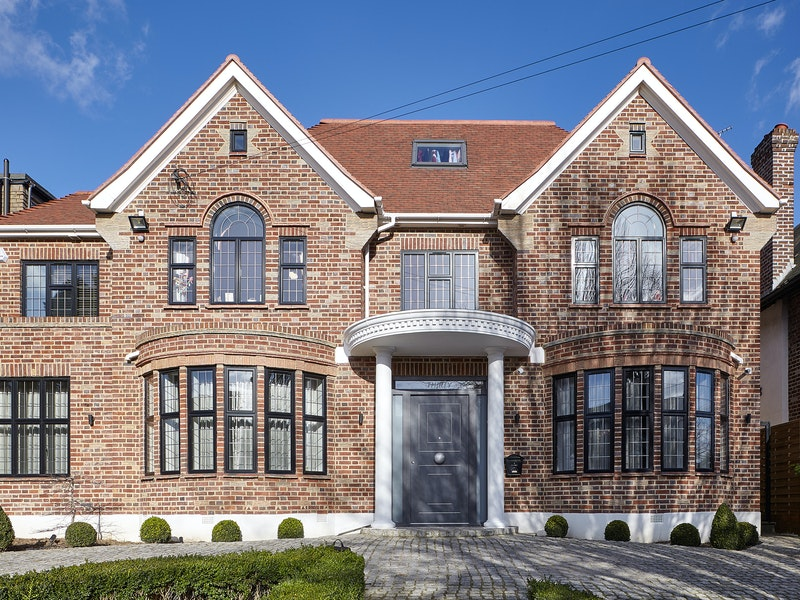 This traditionally styled house has had a thoroughly modern makeover with an Urban Front grey painted front door