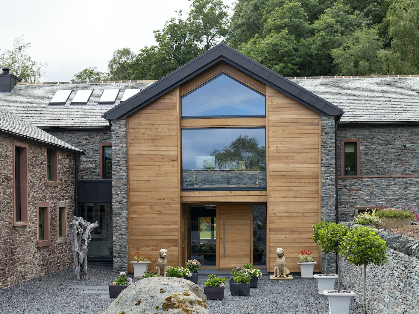 The front door and cladding are both European Oak - but the different design of the front door helps to create an individual identity