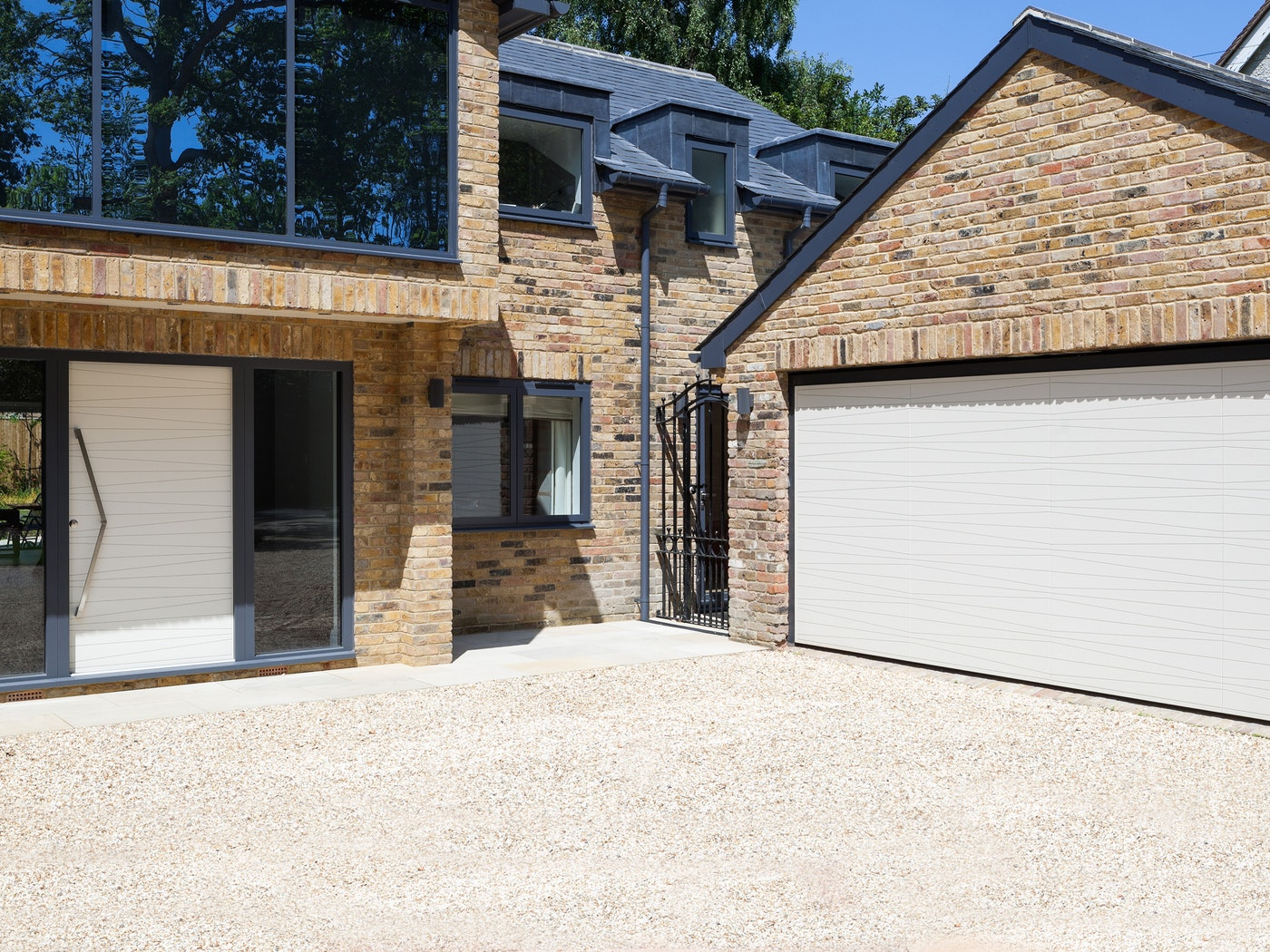 Matching white front & garage doors positioned close together | Urban Front