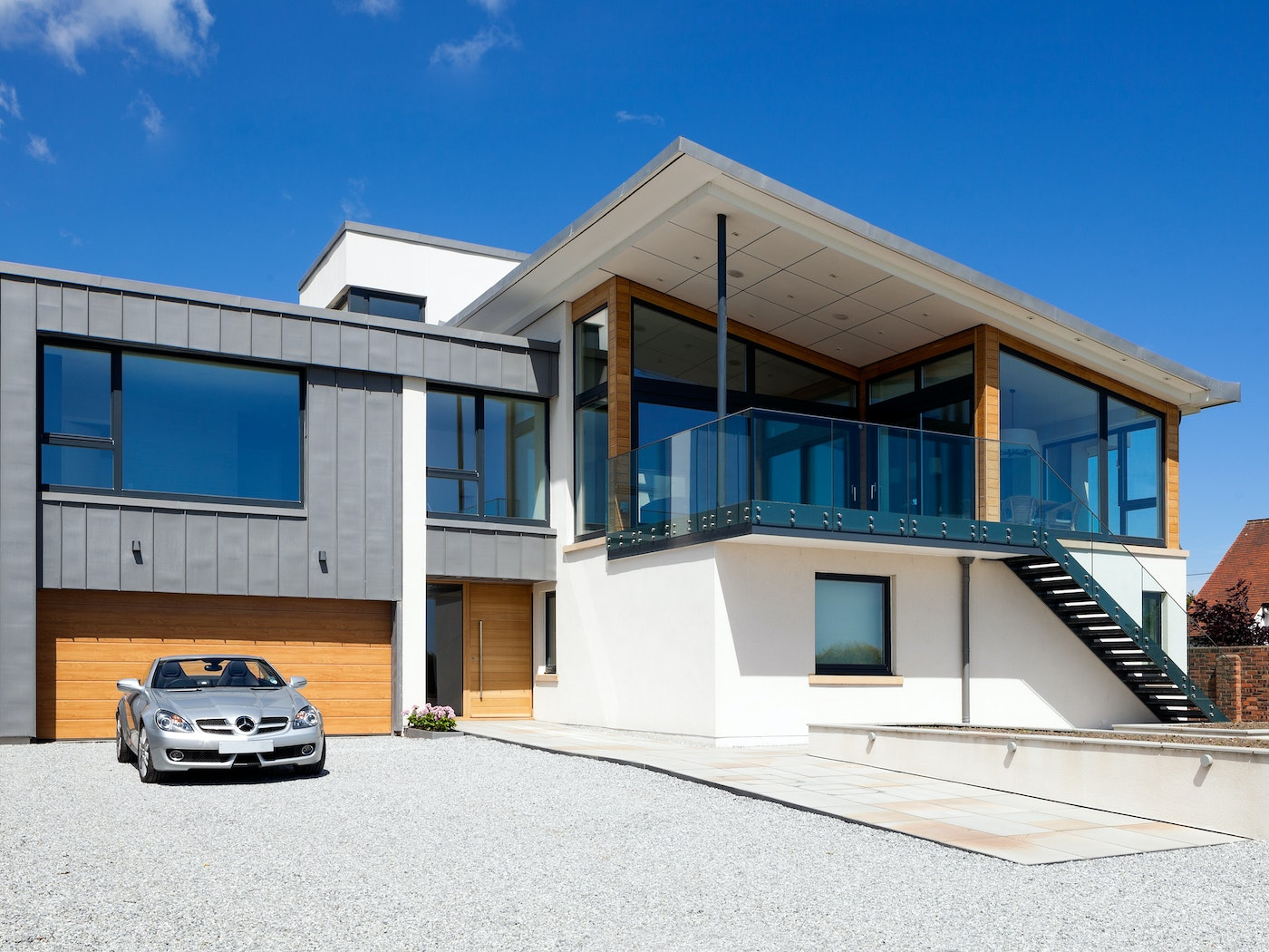 These matching front & garage doors work well in this property that features a lot of different glass and stonework