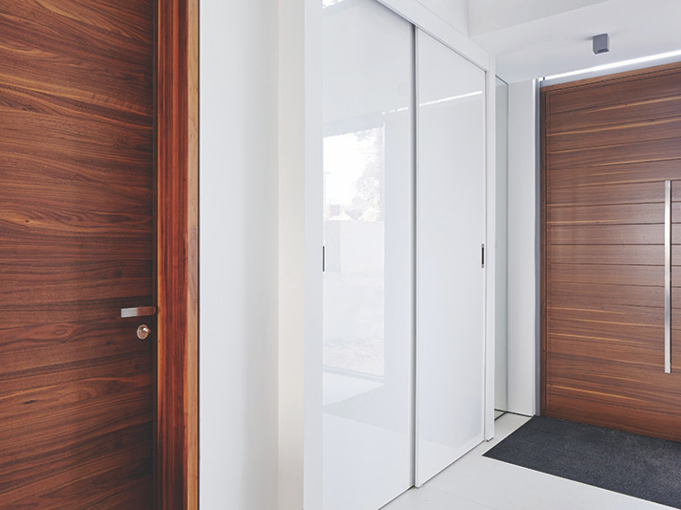 sliding cupboard doors match the wall whilst the front and internal doors are  similar