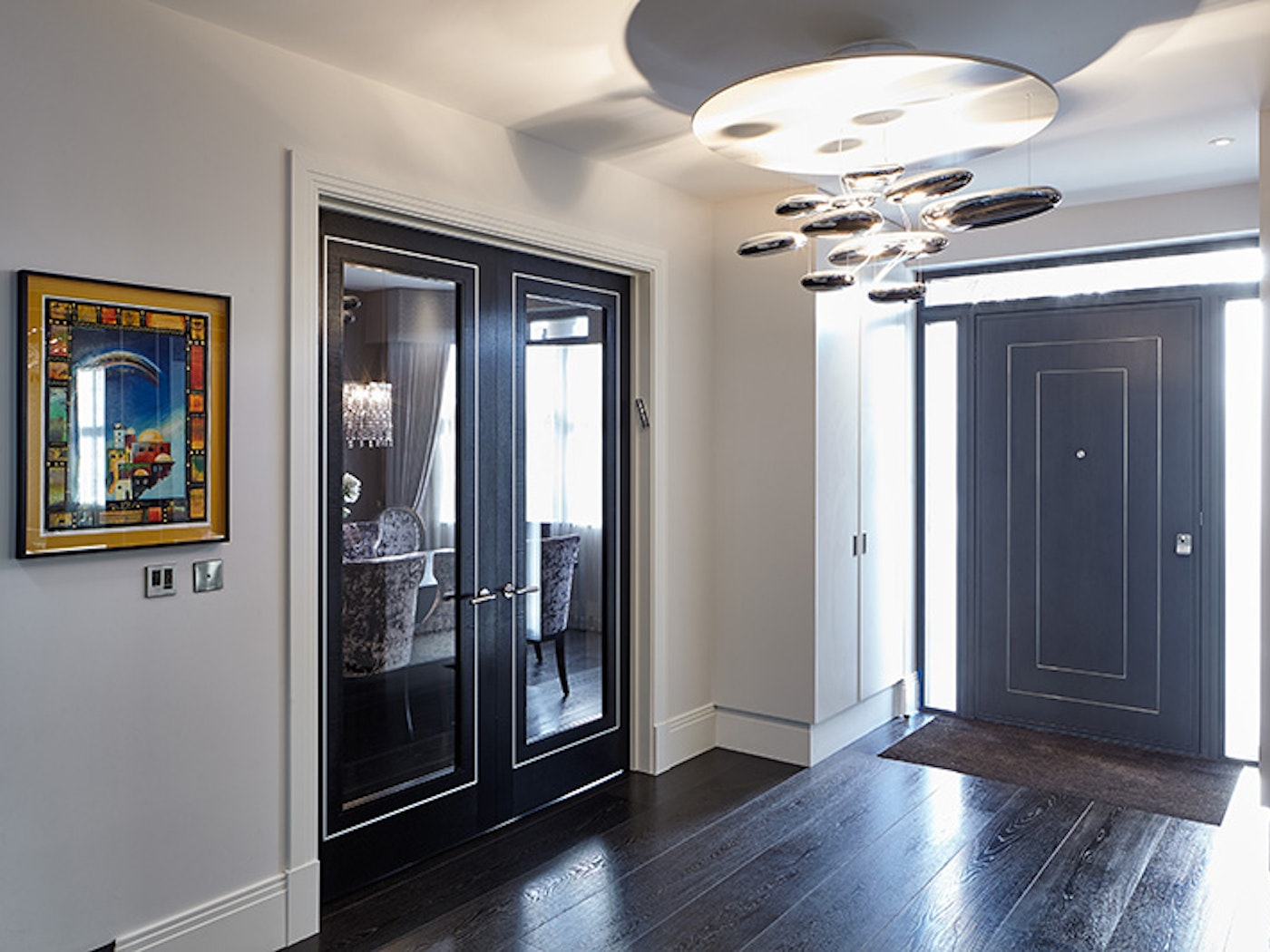 using a  simliar design on the internal doors to match the front doors is perfect here