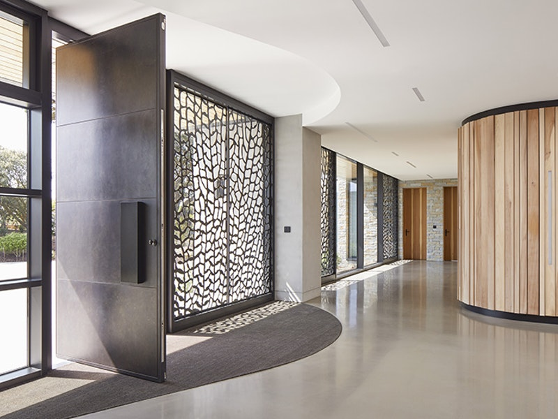 A great example of how different finishes can really work in this hall