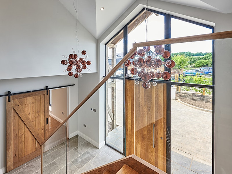 the front door and sliding barn door work really well in this barn conversion