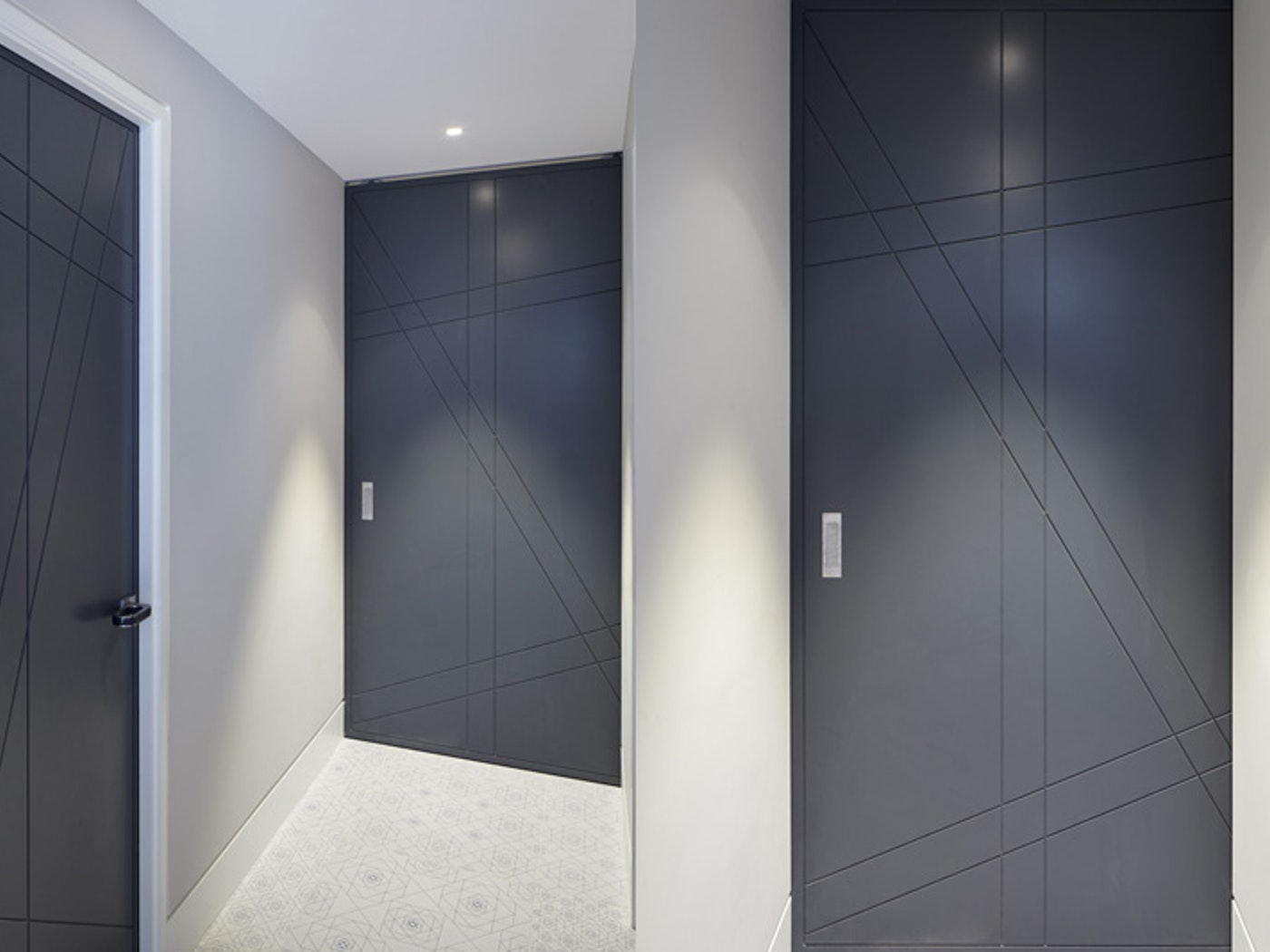 in this hallway the same design and colour have been used as well as a space saving pocket door