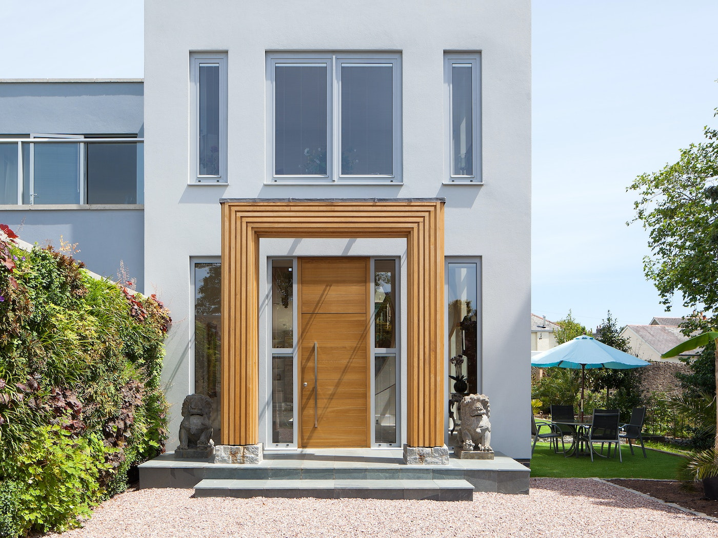 Making a door look bigger that it actually is helps create a grand entrance