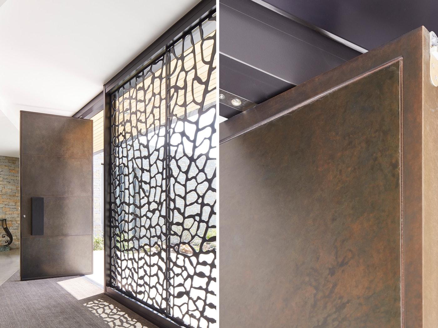 large pivot door in bronze 112