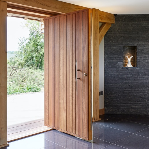what you need to know about pivot doors blog header