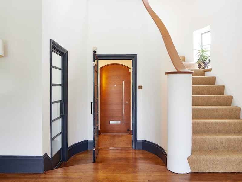The arched front door has a contemporary feel