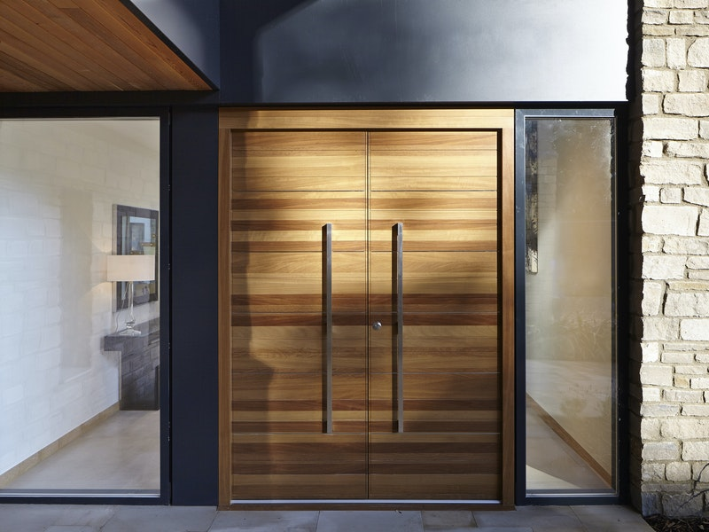 Front double doors in iroko wood with glass side panels (side lights)