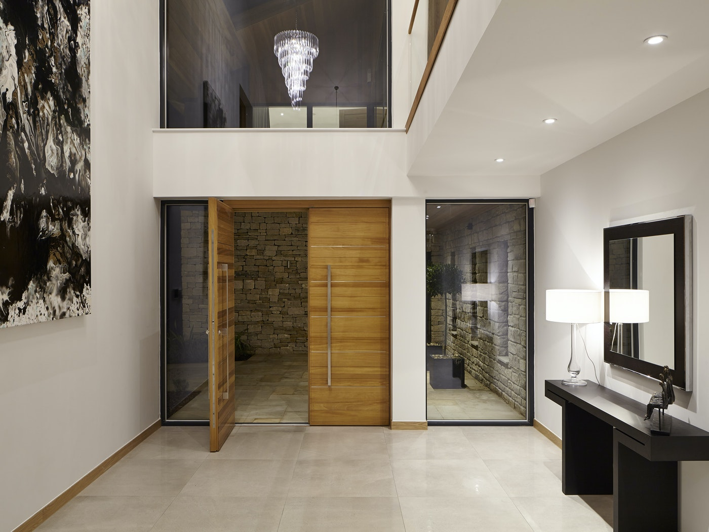 The grand double front doors open into an equally grand internal entrance