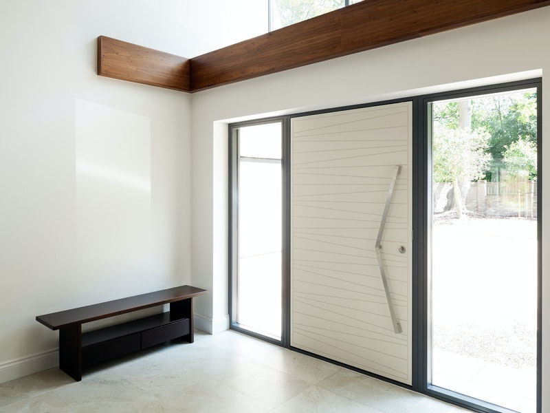 The glass panels next to the front door allow extra internal light