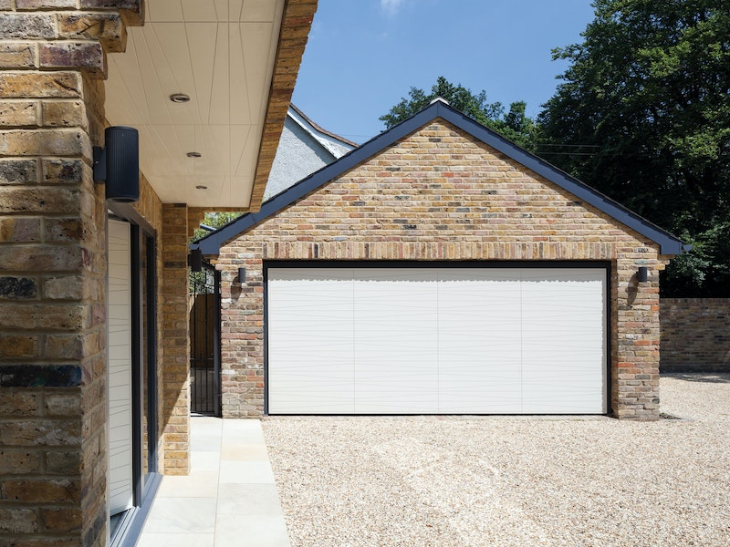 The matching garage door is also the Urban Front Milano design