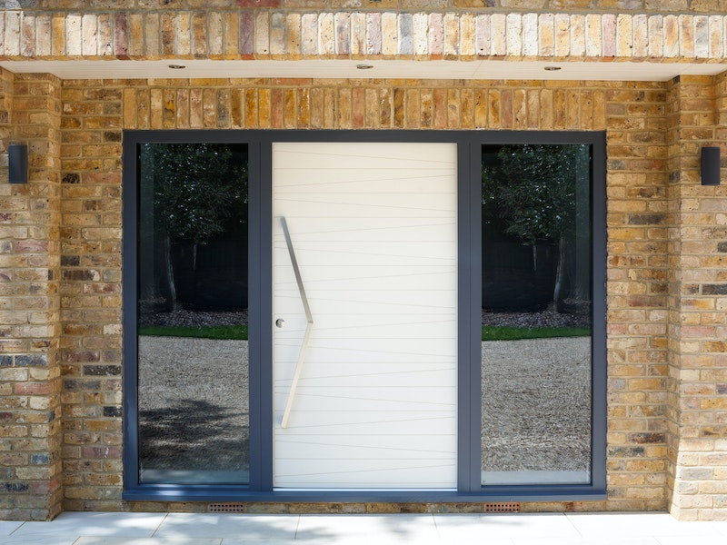 The Milano front door is painted white with an anthracite frame