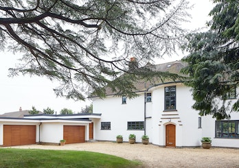 A 1930's house remodelled with matching front and garage doors