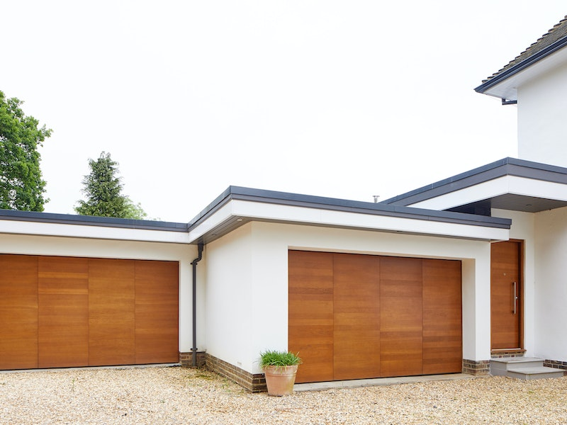 The matching up and over garage doors perfectly complement the traditional house style