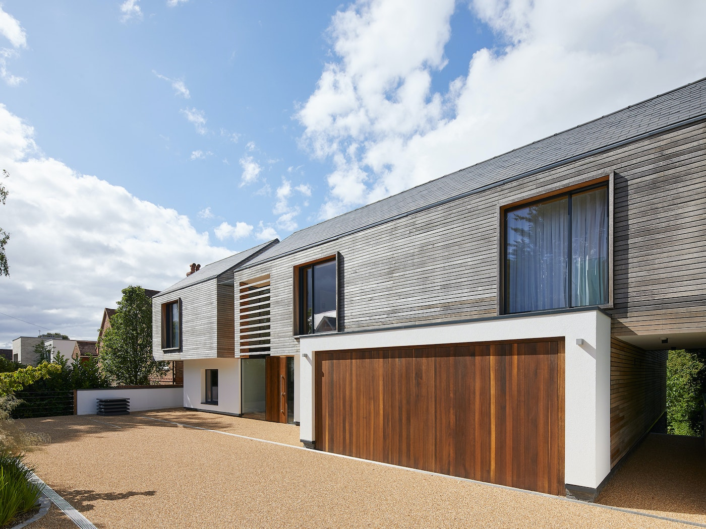 stunning contemporary home with matching door and garage raw v design