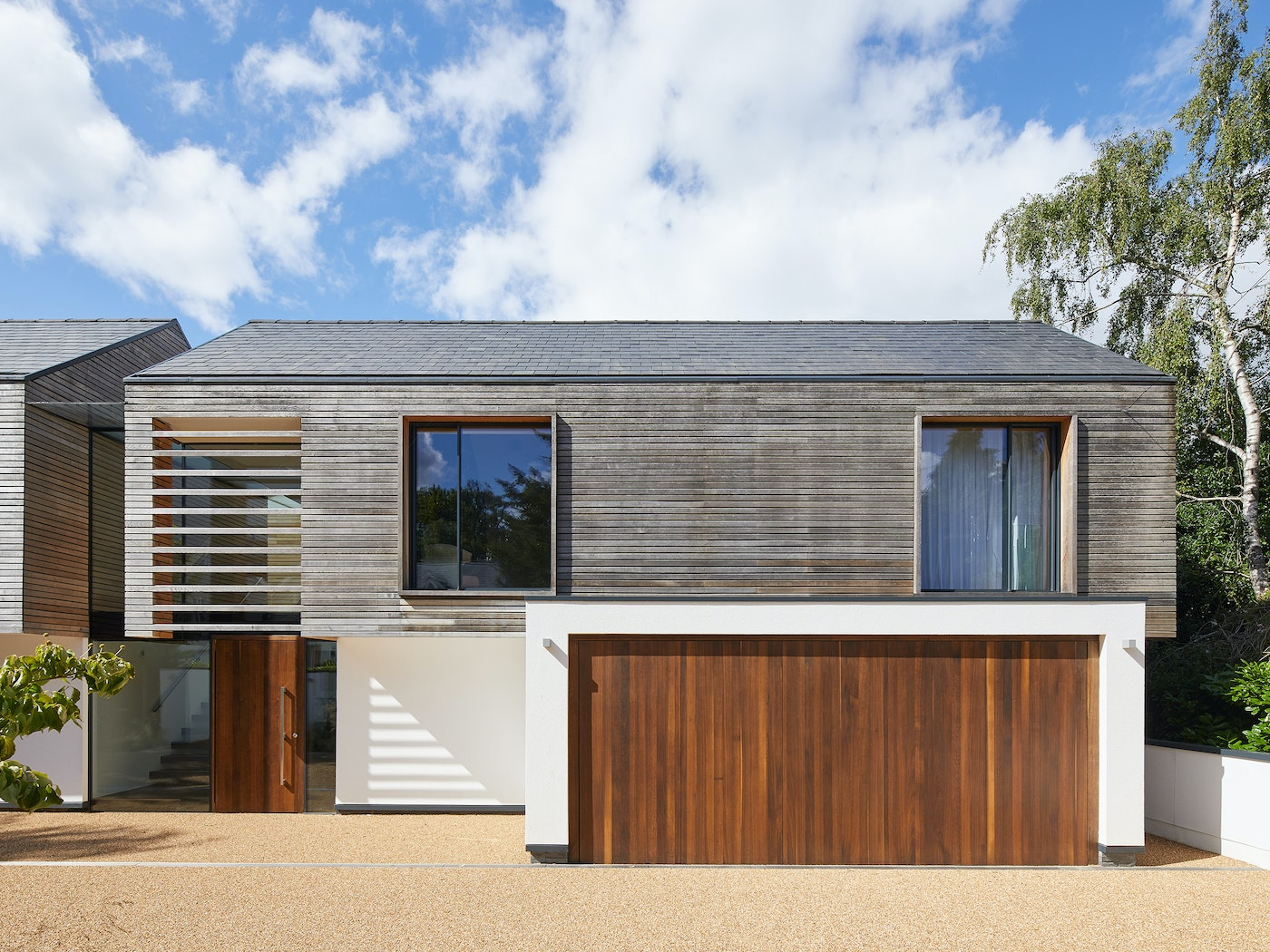 the greyed oak cladding works brilliantly with the fumed oak door and garage