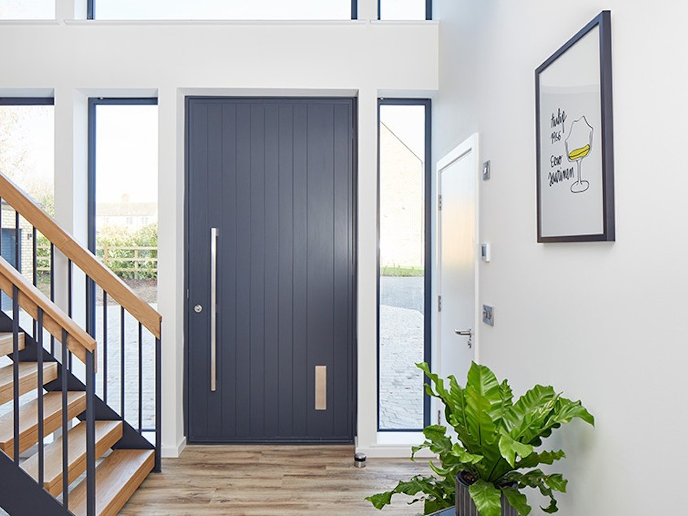 A picture-perfect anthracite grey front door with a contrasting light interior