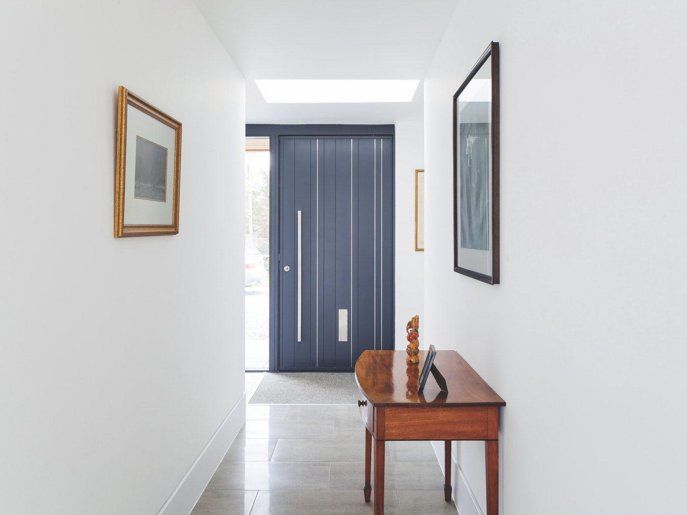 Bright white interiors are a popular choice for grey doors with good reason