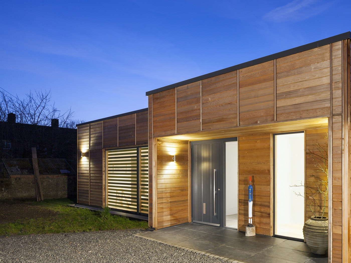 The simple building design works beautifully with the statement grey painted door