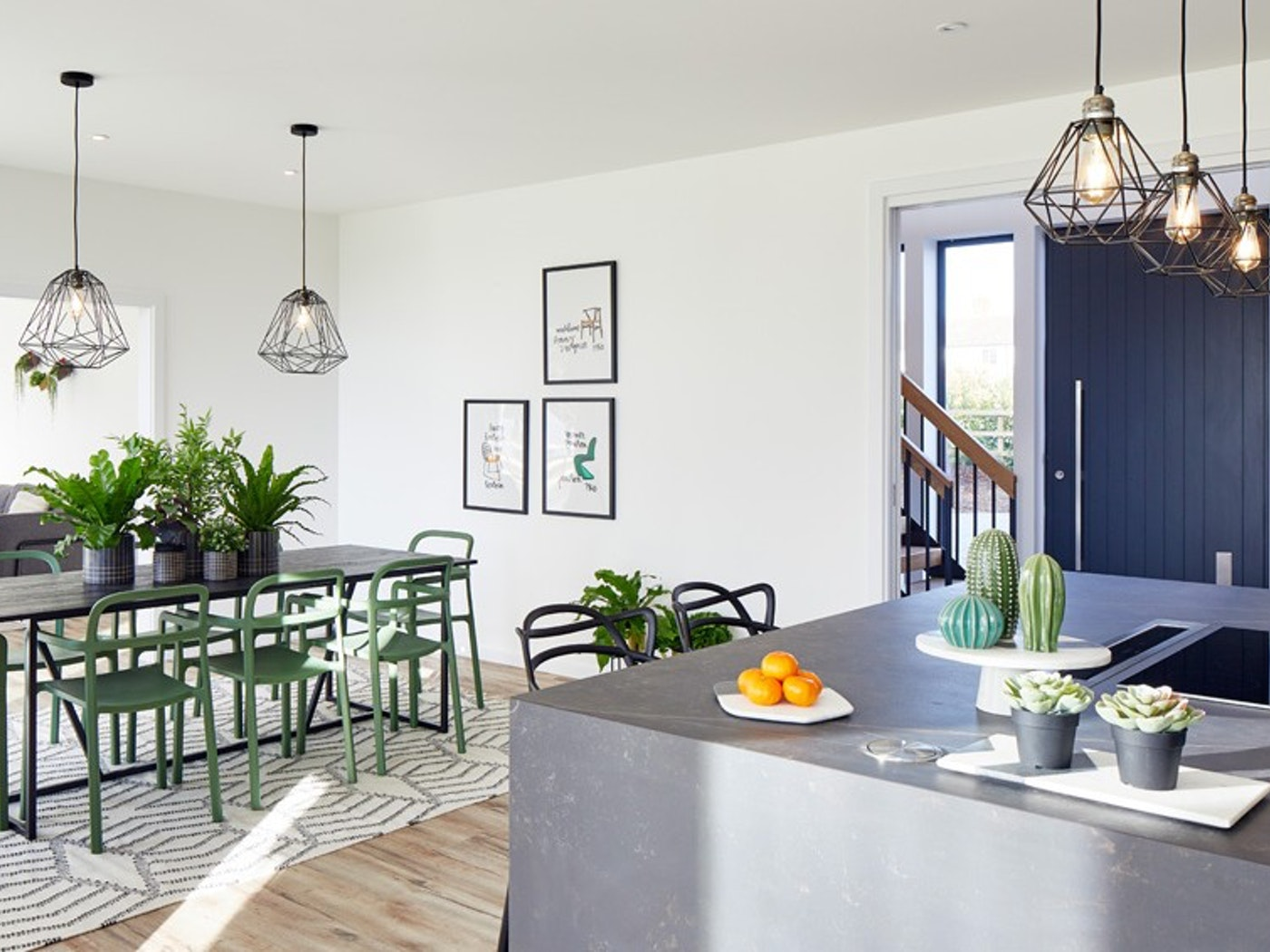 The contemporary feel is continued internally with accents of concrete & green