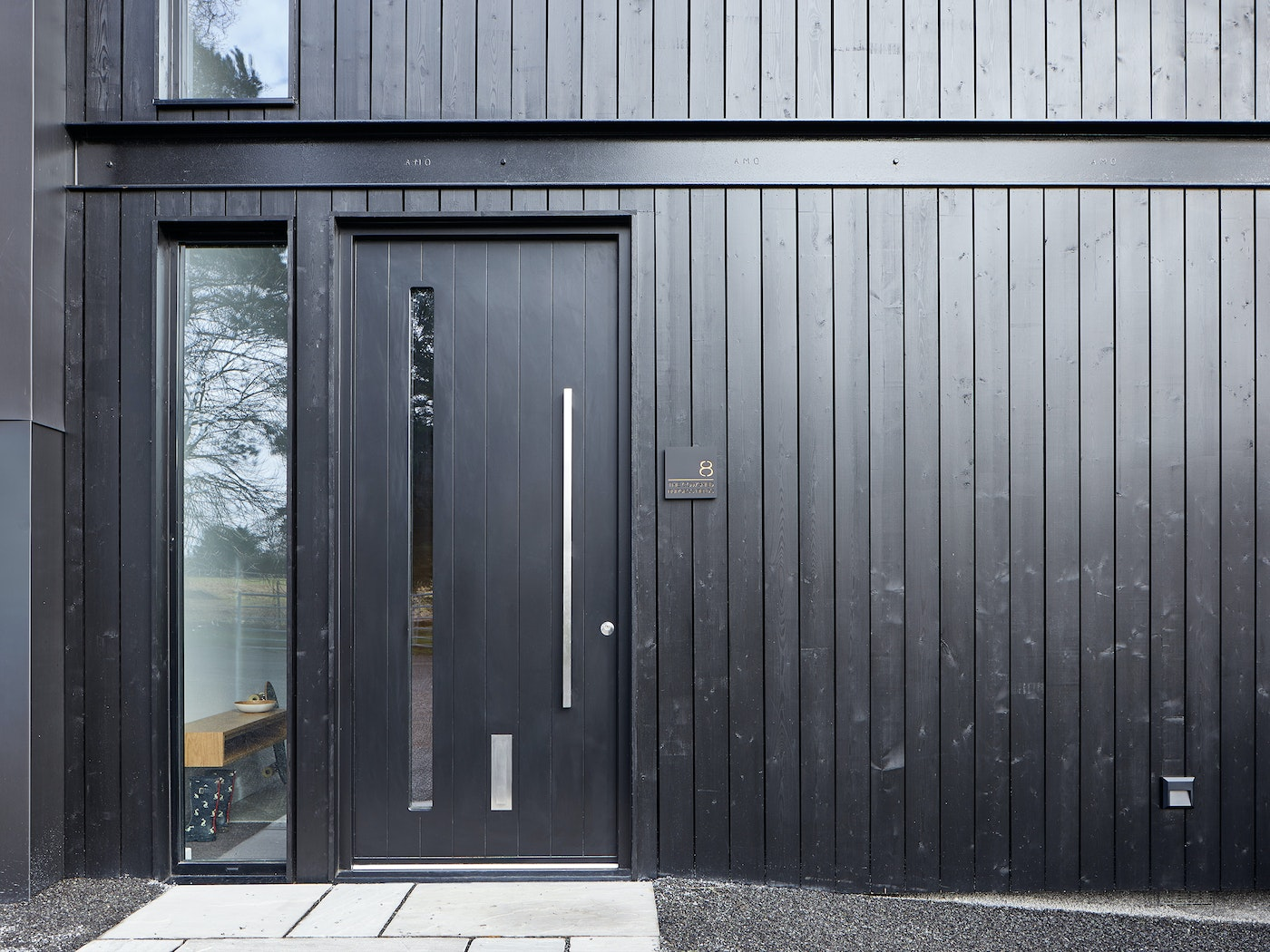 They each feature Urban Front's Terano black front door with glass vision panel