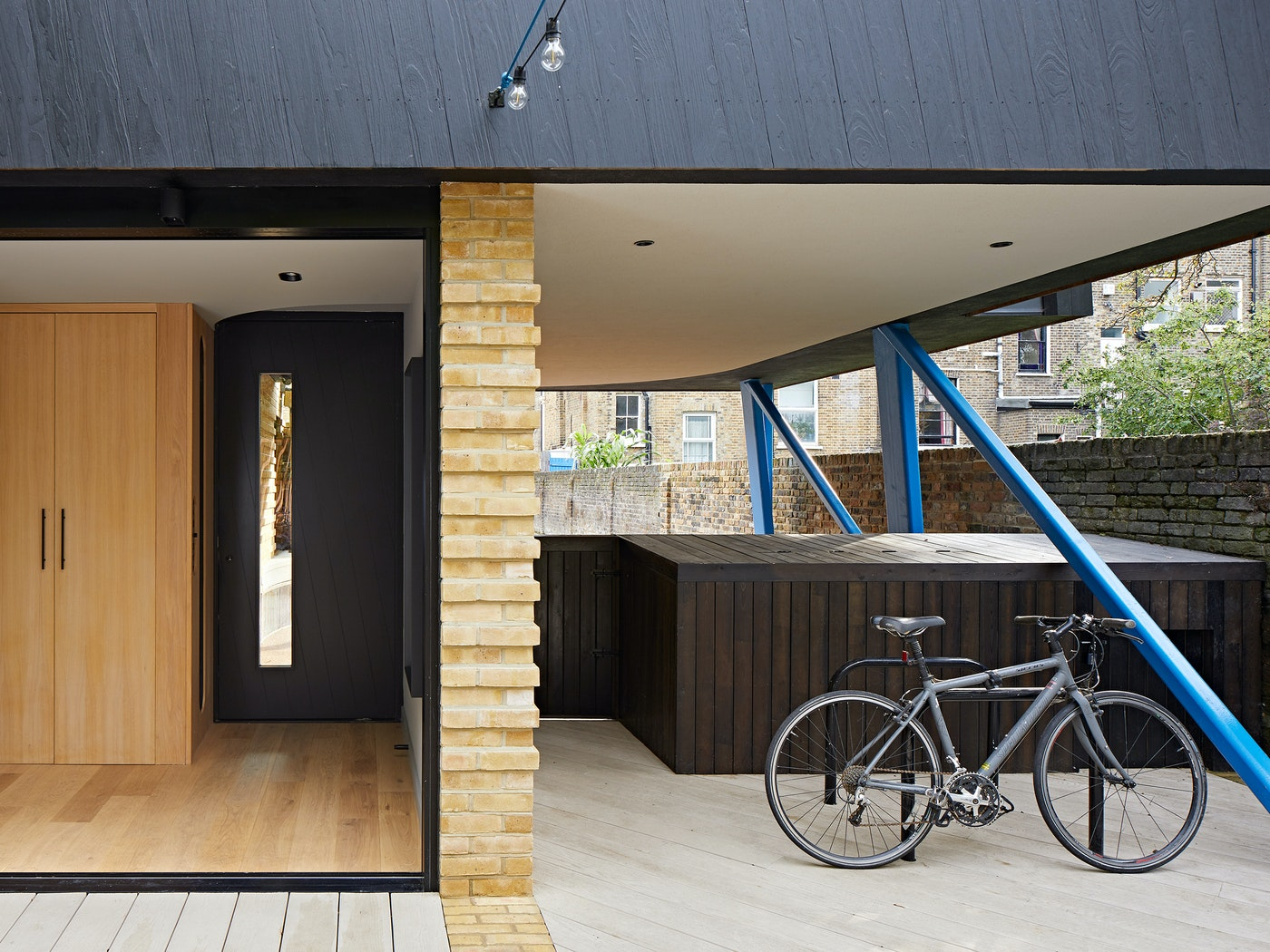 Housed within a variety of other building materials & colours, the black door & cladding offer the perfect neutral base