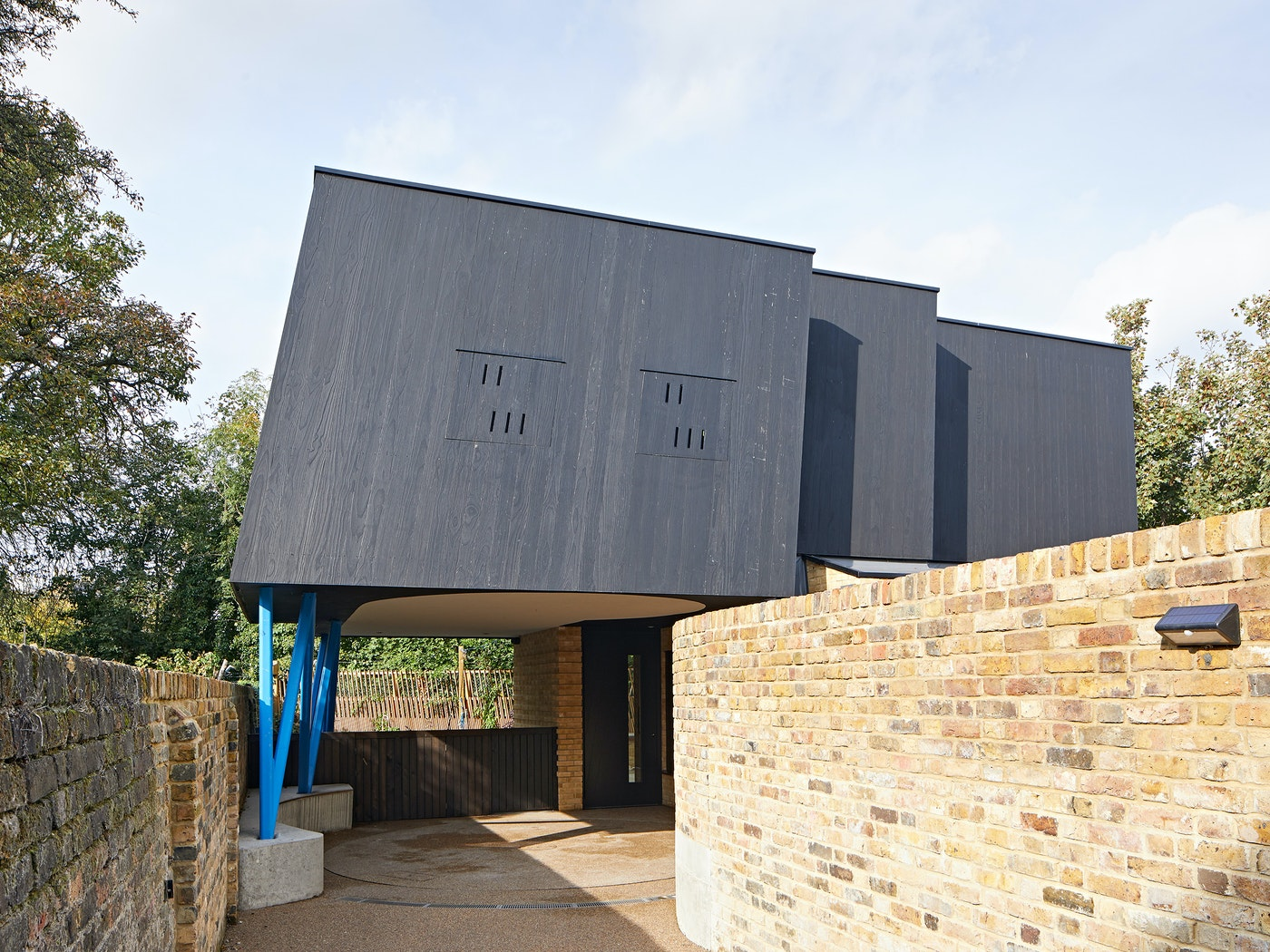 This unusual and fabulously contemporary design features our Terano black front door tucked away almost out of view