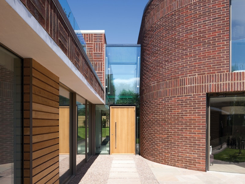 Rondo V Oak front door in a contemporary house with glass framing
